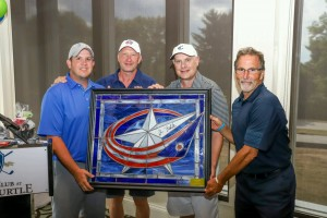 Foursome George Choposky, Jarmo Kekalainen, Anthony Rothman and John Tortorella with stained glass logo for auction